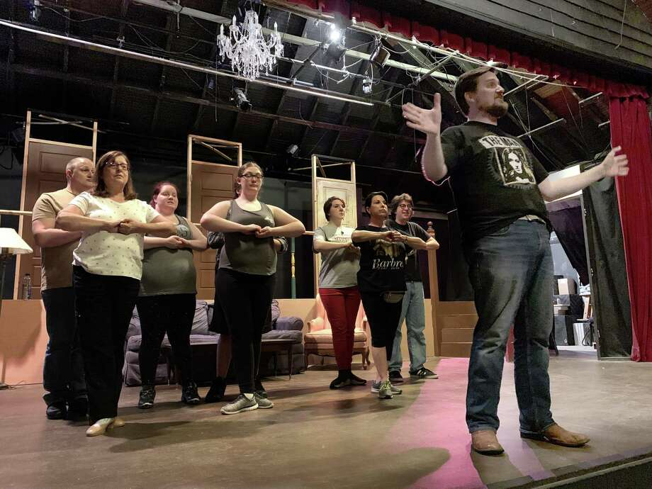 "Eli Patton, as ""Watchdog"" Melvin P. Thorpe, leads the Angelettes during a rehearsal for ""The Best Little Whorehouse in Texas"" at Brookfield Theatre for the Performing Arts. The show will be onstage June 28 through July 20. Photo: Rob Kruzykowski / Contributed Photo"