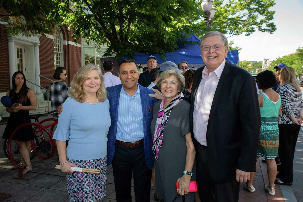 HARMAN CFO Sandy Rowland, HARMAN CEO Dinesh Paliwal, Stamford Downtown Special Services District President Sandy Goldstein and Stamford Mayor David Martin celebrate Make Music Day at the HARMAN Street Studio in downtown Stamford in 2018.