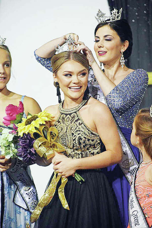 Anja Goetten of Carrollton is crowned the 2019 Miss Greene County Fair by 2018 Queen Alex Roberts on Monday evening in Carrollton.
