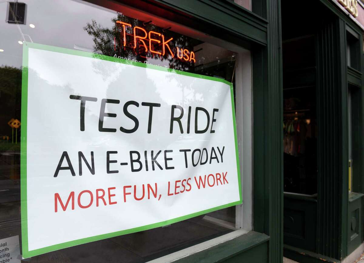 Sign promotes the sale of e-bikes at The Downtube Bicycle Works on Tuesday, June 18, 2019, in Albany, N.Y. (Will Waldron/Times Union)