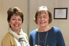 The Women's Club of Cheshire welcomed Deborah Rudder Deputy Director from the Cheshire Public Library, at its meeting in May. Above right, Delores Barker, first vice president of the club, joins Deborah Rudder at the meeting.