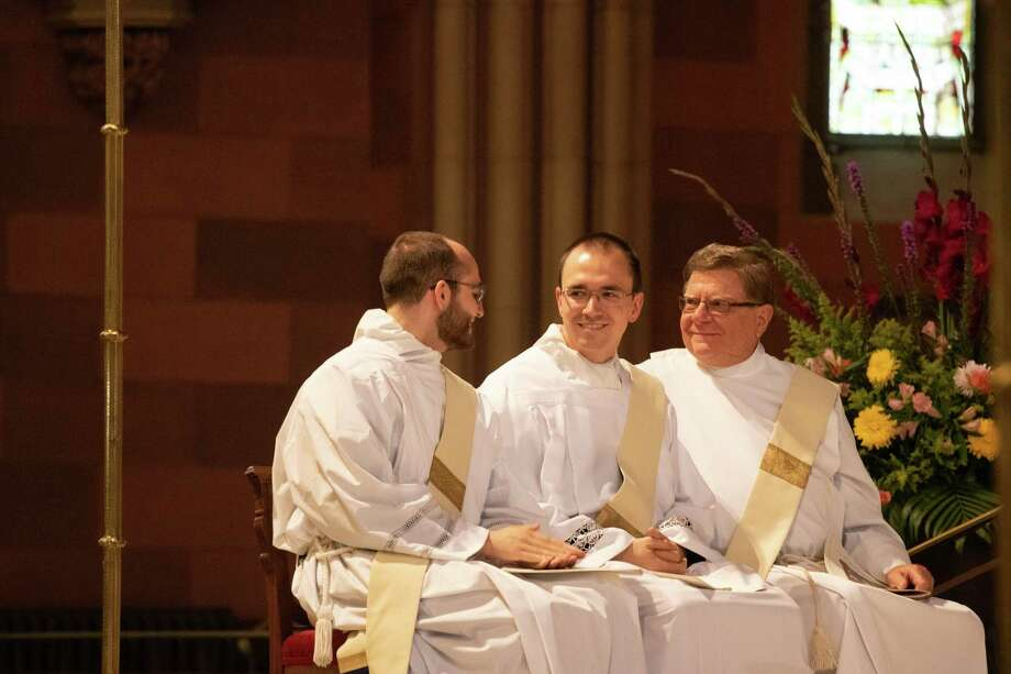 Samuel Bellafiore, Kyle Eads and Michael Melanson become priests in the Albany Roman Catholic Diocese Saturday, June 15, 2019 in Albany.  (Kate Costello)