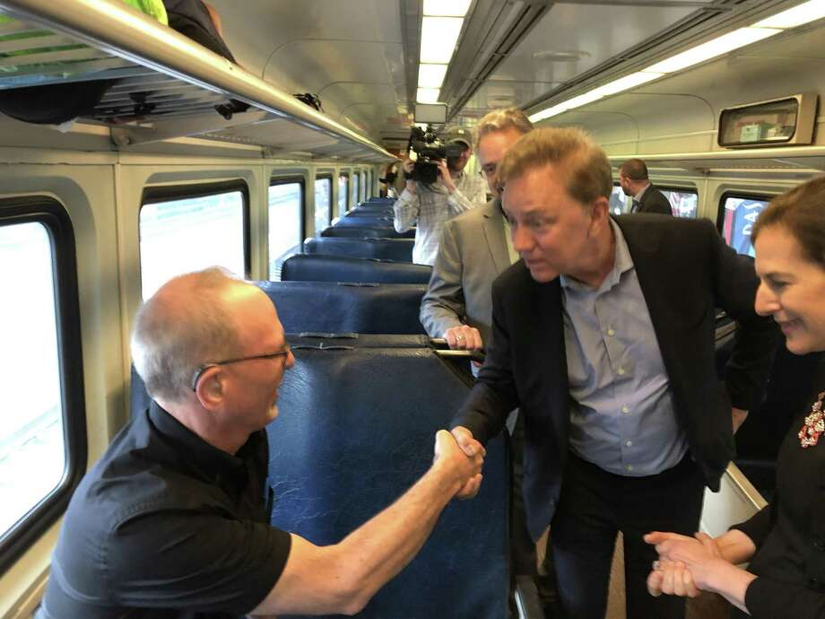 Gov. Ned Lamont, center, and Lt. Gov. Susan Bysiewicz greet Harford Line rider William Erich Krengel of Hartford on the 11:35 a.m. run Monday, June 17, 2019, leaving from Union Station in New Haven. Photo: Ed Stannard / Hearst Connecticut Media