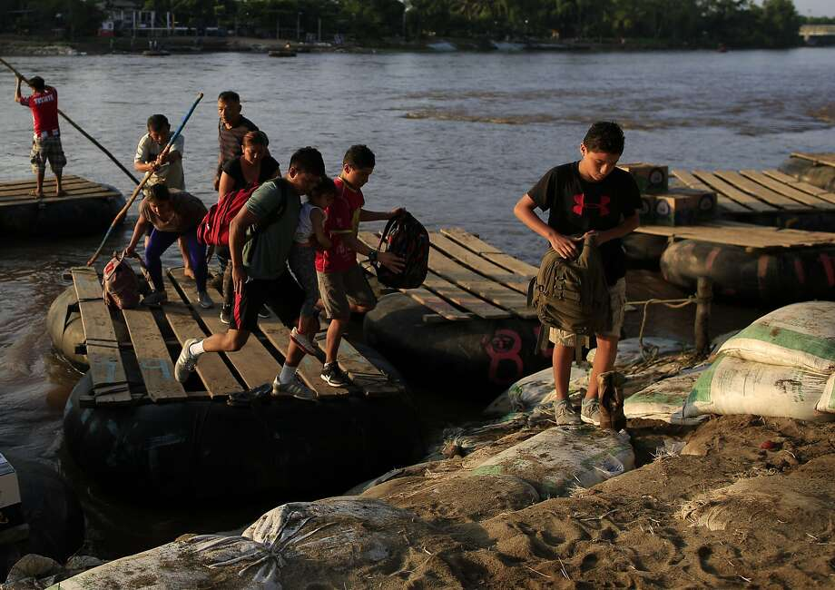 Migrants from Guatemala disembark from a raft in Ciudad Hidalgo, Mexico. The number of migrants using rafts here have decreased significantly here. Photo: Rebecca Blackwell / Associated Press