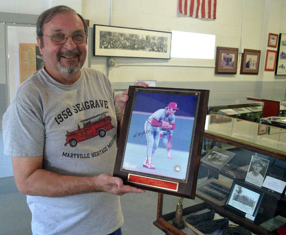Keith Oberkfell displays a photo of his cousin, former St. Louis Cardinals third baseman Ken Oberkfell, at the Maryville Heritage Museum. Keith and his wife Marcia hope to raise money to paint a mural on the museum of Ken Oberkfell and three other former Major League Baseball players from Maryville. Photo: Scott Marion | The Intelligencer