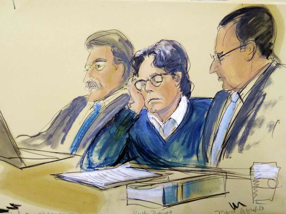 In this courtroom artist's sketch, defendant Keith Raniere, center, sits with attorneys Paul DerOhannesian, left, and Marc Agnifilo during closing arguments at Brooklyn federal court, Tuesday, June 18, 2019 in New York. A federal prosecutor said Raniere used his NXIVM organization to