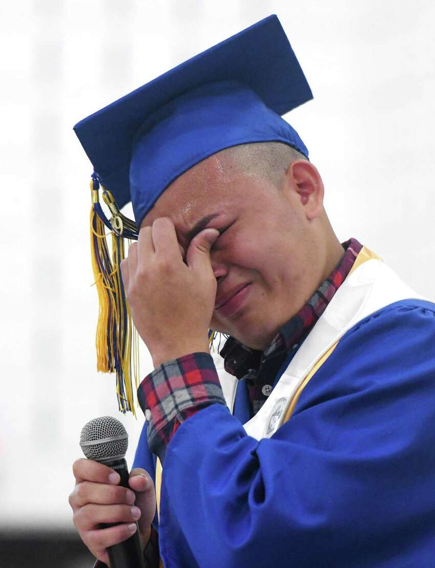 Salutatorian Kevin Membreno breaks down in tears during his Salutatory Address at the 93rd Annual Commencement at Warren Harding High School in Bridgeport, Conn. Tuesday, June 18, 2019. The Class of 2019 was the first to graduate from the new Warren G. Harding High School on the long-awaited Bond Street location.