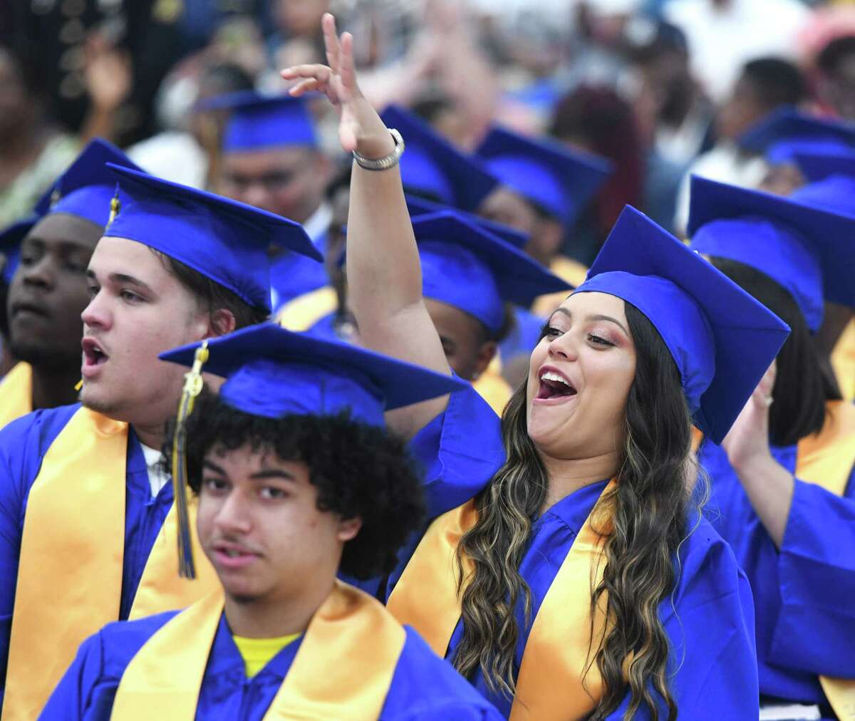 Graduating senior Damarys Seda cheers during the 93rd Annual Commencement at Warren Harding High School in Bridgeport, Conn. Tuesday, June 18, 2019. The Class of 2019 was the first to graduate from the new Warren G. Harding High School on the long-awaited Bond Street location.