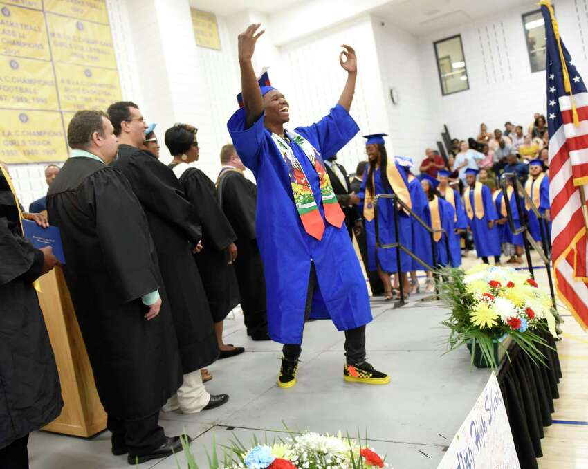 Dodley Faure dances while walking across the stage to receive his diploma at the 93rd Annual Commencement at Warren Harding High School in Bridgeport, Conn. Tuesday, June 18, 2019. The Class of 2019 was the first to graduate from the new Warren G. Harding High School on the long-awaited Bond Street location.