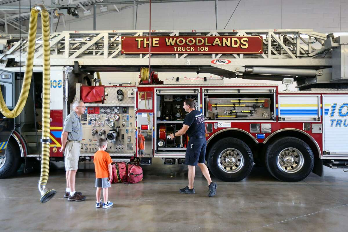 At some point this summer, each fire station in The Woodlands will roll up their garage doors for community members to come and see their public safety equipment in a series of open houses. Here, The Woodlands firefighter Jason Brown chats with attendees of the open house on Saturday, July 15, 2017, at The Woodlands Fire Station #6.