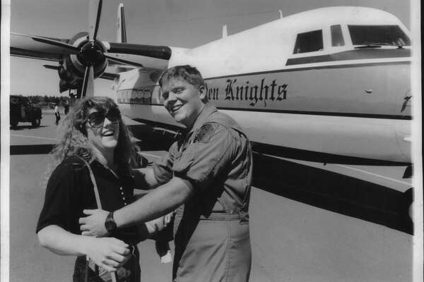 Schenectady County Airport, New York - Watervliet native, now crew chief for Fokker F27 aircraft used by Army's Golden Knights parachute team, Steve Leibach gets a welcome home hug from sister Tracey prior to parachute demonstration Friday afternoon. August 25, 1989 (John Carl D'Annibale/Times Union Archive)