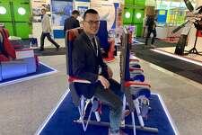 "TravelSkills correspondent Tim Jue tries out Avio Interior's ""SkyRider"" saddle-like airplane seat at the Paris Air Show"