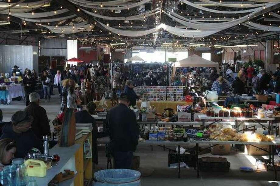 Pickers peruse the Grafton Riverside Flea Market at The Loading Dock in April.