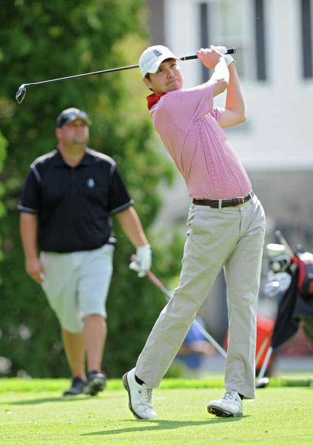 Ben Bates, right, of Mohawk Golf Club hits a tee shot during the first round of the New York State Golf Association Mid-Amateur Golf Tournament at Wolferts Roost Country Club on Friday, Sept. 25, 2015 in Albany, N.Y. (Lori Van Buren / Times Union) Photo: Lori Van Buren, Albany Times Union / 00031866A