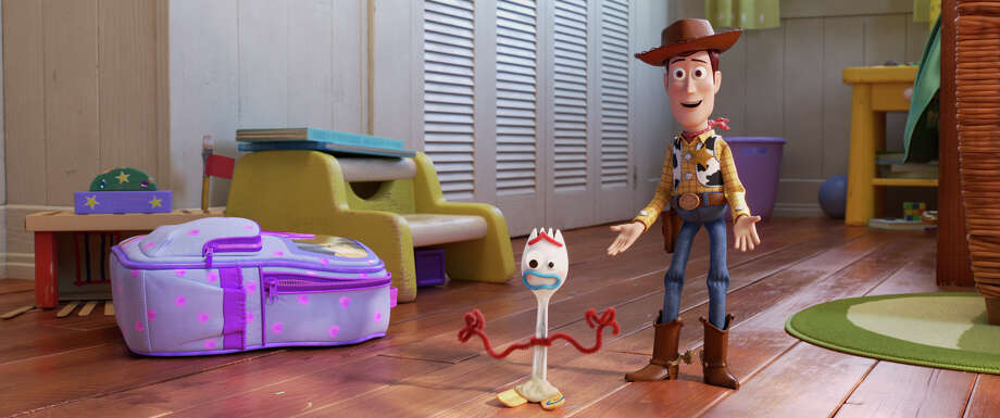 """Sheriff Woody (voice of Tom Hanks, right) returns in """"Toy Story 4,"""" an animated sequel that introduces us to Forky (Tony Hale), a craft project made from a discarded spork. Photo: Walt Disney Pictures/Pixar Animation Studios / ©2019 Disney/Pixar"""