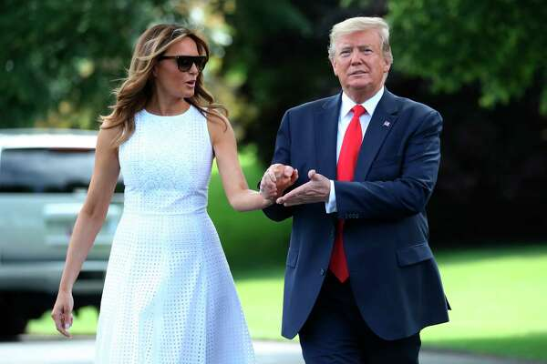 President Donald Trump walks with first lady Melania Trump before boarding Marine One on the South Lawn of the White House, Tuesday, June 18, 2019, for a short trip to Andrews Air Force Base, Md., and then on to Orlando, Fla. for a rally.