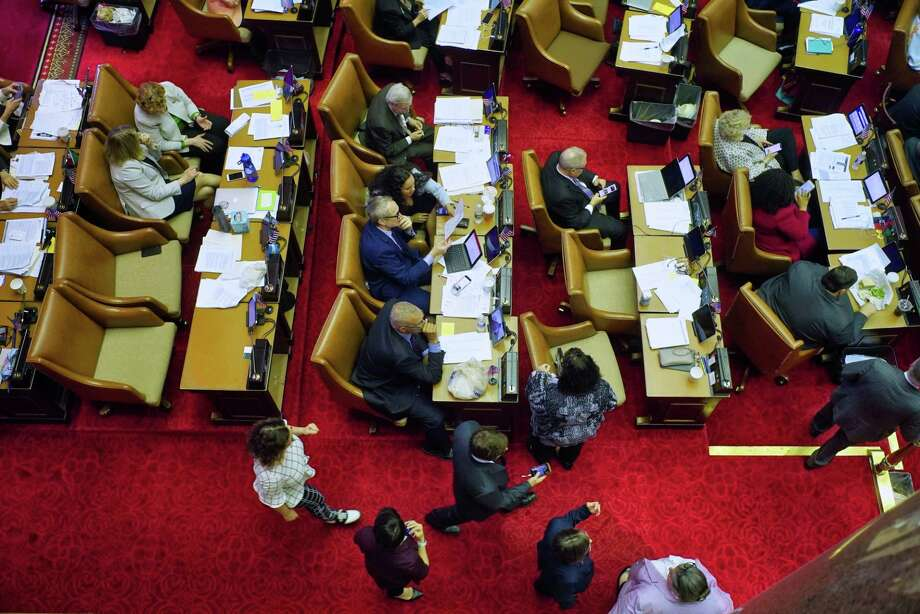 Members of the State Assembly work at their desks as they voted on bills on Tuesday, June 18, 2019, in Albany, N.Y.   (Paul Buckowski/Times Union) Photo: Paul Buckowski, Albany Times Union / (Paul Buckowski/Times Union)