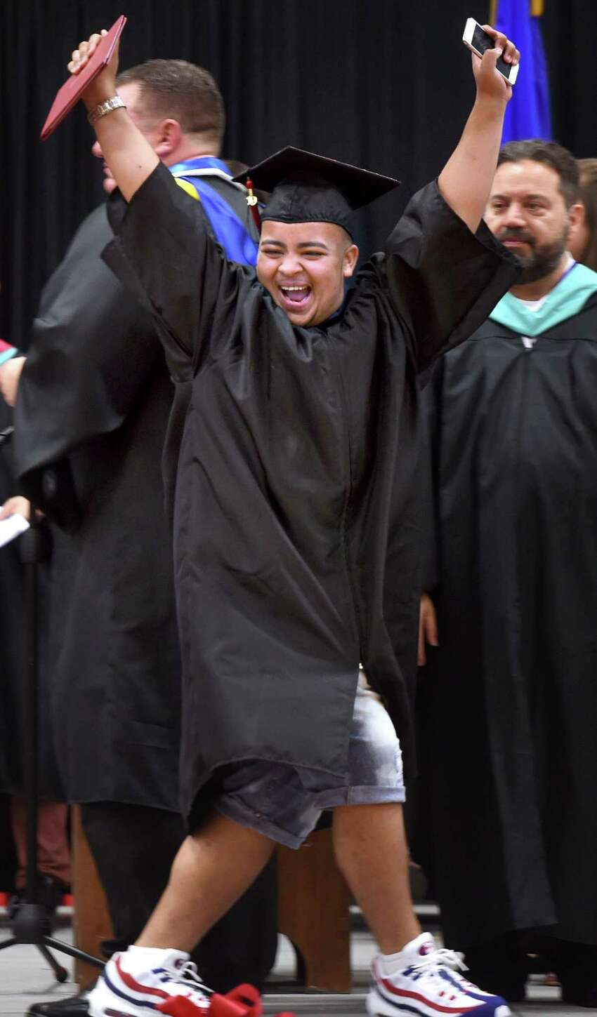 Taj-Amir Oquendo celebrates after receiving his diploma during graduation exercises at Central High School in Bridgeport on June 18, 2019.