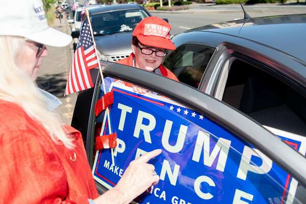 Supporters of Donald Trump place signs on their cars before embarking on a 4-mile long caravan, (one mile for every year of the next Trump Presidency), in celebration of the anticipated campaign re-elect announcement in Novato, California on, Tuesday June 18th 2019.