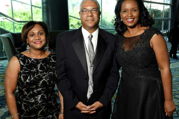 """From left: Honoree Vanessa Wyche, HAUL Board Chair Judson Robinson and honorary chair Winell Herron at the Houston Area Urban League """"Equal Opportunity"""" Gala at the Hilton Americas Hotel Saturday June 15, 2019.(Dave Rossman Photo)"""