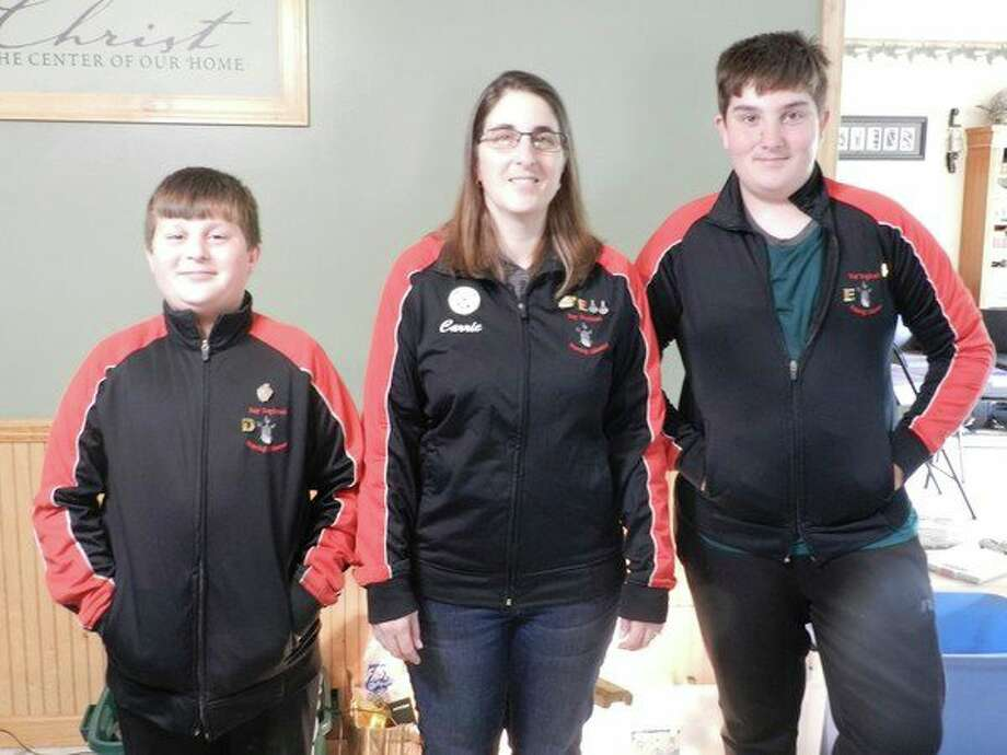 Pictured, fromleft, are Luke Owens, Carrie Owens and Andrew Owens
