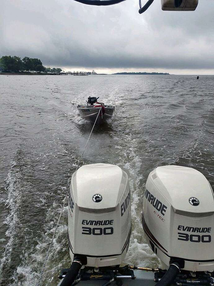 The Norwalk, Conn., police provided this image of the boat being towed by Norwalk police on Tuesday, June 18, 2019. Photo: Contributed Photo / Norwalk Police Department /