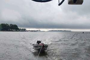 The Norwalk, Conn., police provided this image of the boat being towed by Norwalk police on Tuesday, June 18, 2019.