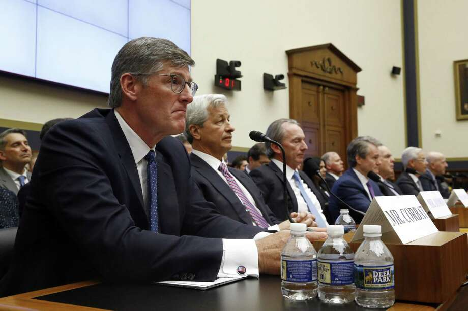 Citigroup CEO Michael Corbat, left, testifies alongside members of major banks before the House Financial Services Committee during a hearing, Wednesday, April 10, 2019, on Capitol Hill in Washington. (AP Photo/Patrick Semansky) Photo: Patrick Semansky, STF / Associated Press / Copyright 2019 The Associated Press. All rights reserved.