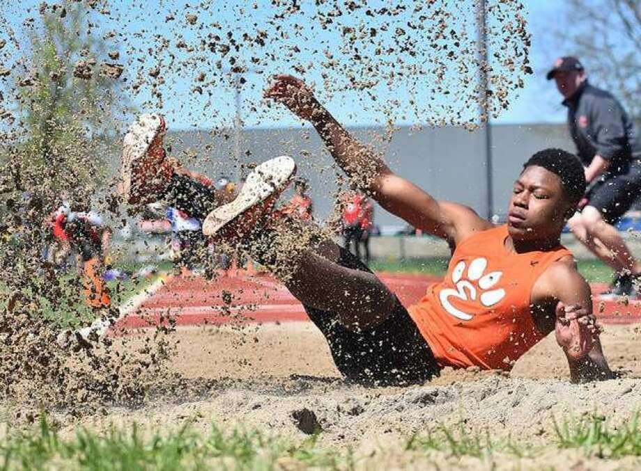 Edwardsville long jumper Kenyon Johnson lands after leaping 22-9 to finish second in the event at the Winston Brown Track and Field Invitational on April 20. Photo: Matt Kamp/The Intelligencer