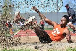 Edwardsville long jumper Kenyon Johnson lands after leaping 22-9 to finish second in the event at the Winston Brown Track and Field Invitational on April 20.
