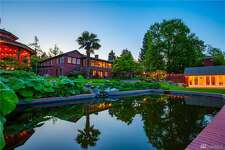 """This Lake Washington """"compound"""" includes five bedrooms and five baths in its 6,242 square feet of space. It also includes 124 feet of shoreline, a private dock, a beach cabana and views of Mount Rainier. The home is for sale for $7.5 million."""
