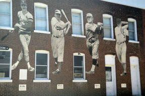 """A preliminary design by artist Troy Freeman of a proposed mural on the Maryville Heritage Museum that would depict the four former Major League Baseball players from Maryville, including left to right, Ken Oberkfell, Dwain Sloat, John C. """"Buster"""" Lucas and Bob Boken."""