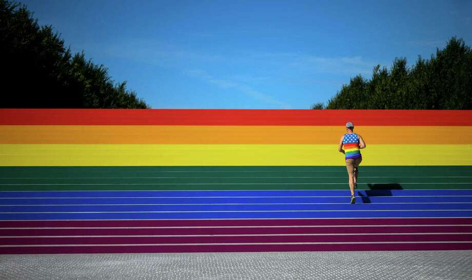A man walks on steps covered in rainbow colors for Pride Month at Franklin D. Roosevelt Four Freedoms Park on Friday in New York City. Here's what allies of the LGBTQ community can give: 100 percent support. Photo: JOHANNES EISELE /AFP /Getty Images / AFP or licensors