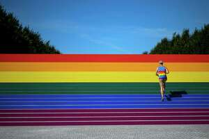 A man walks on steps covered in rainbow colors for Pride Month at Franklin D. Roosevelt Four Freedoms Park on Friday in New York City. Here's what allies of the LGBTQ community can give: 100 percent support.