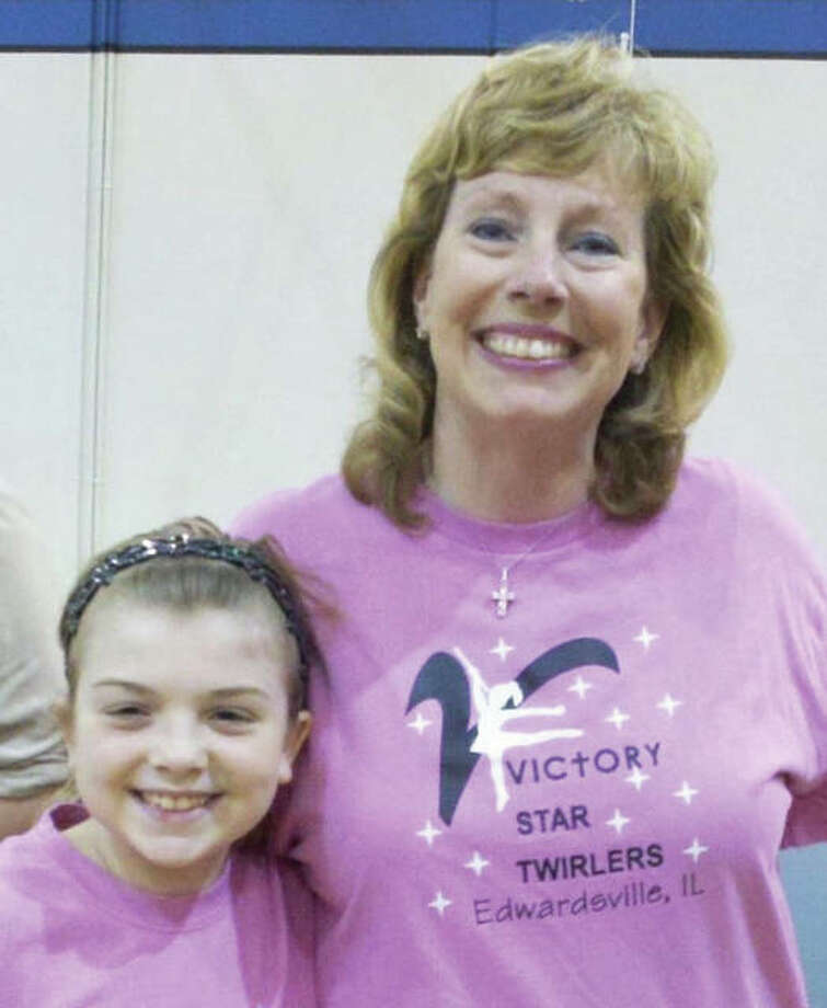Baton twirling teacher Beth Duncan, who teaches privately through her baton twirling organization, Victory Star Twirlers and Twirl Teams, which she founded in approximately 2001, with an early student, Emilee Adams, who recently graduated from high school. Photo: For All About