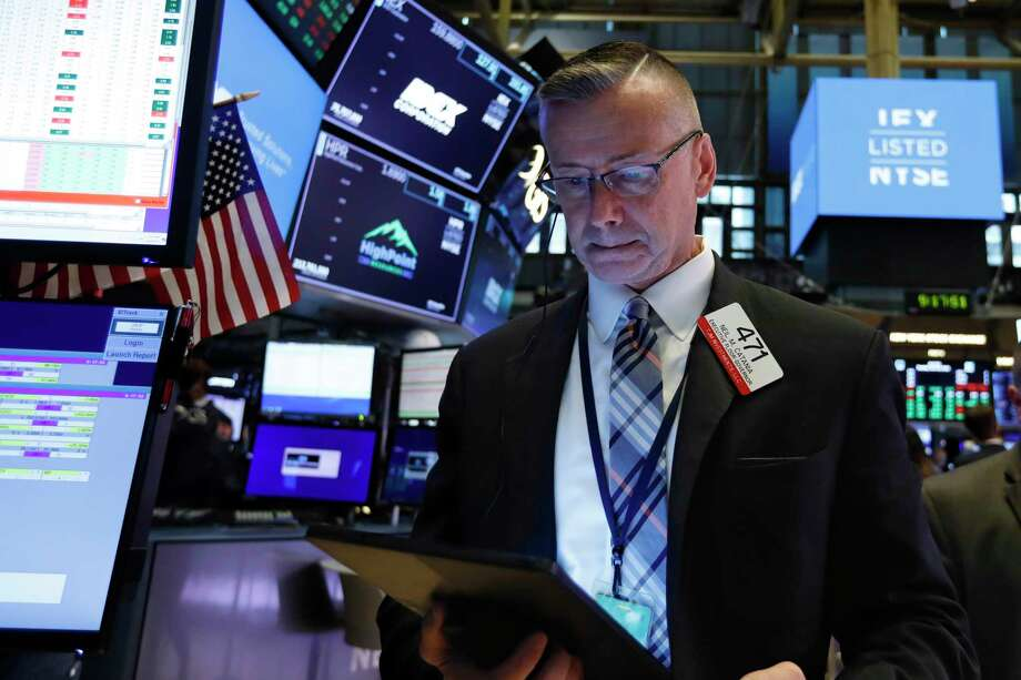 Trader Neil Catania works on the floor of the New York Stock Exchange, Tuesday, June 18, 2019. Stocks are opening higher on Wall Street following big gains in Europe after the head of the European Central Bank said it was ready to cut interest rates and provide more economic stimulus if necessary. (AP Photo/Richard Drew) Photo: Richard Drew / Copyright 2019 The Associated Press. All rights reserved.