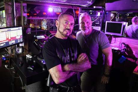 Dirty Disco DJs JD Arnold, left, and DJ Mark D, also known as Mark De Lange, stand for a portrait at De Lange's bar, The Eagle, in Houston. (Michael Ciaglo / Houston Chronicle)