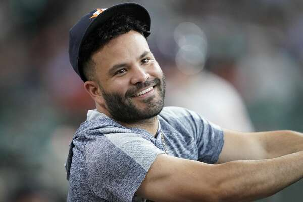 Houston Astros' Jose Altuve watches from the dugout during the first inning of a baseball game against the Chicago Cubs Wednesday, May 29, 2019, in Houston. (AP Photo/David J. Phillip)