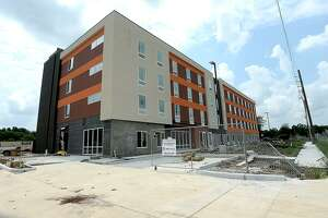 New hotels are under construction in the commercial area along Interstate 10 near Walden Road, including a new complex among the hotels near Tinseltown. The growth signals the growing demand for accommodations as regional tournaments and other tourism opportunities grow in the region. Photo taken Friday, May 31, 2019 Kim Brent/The Enterprise