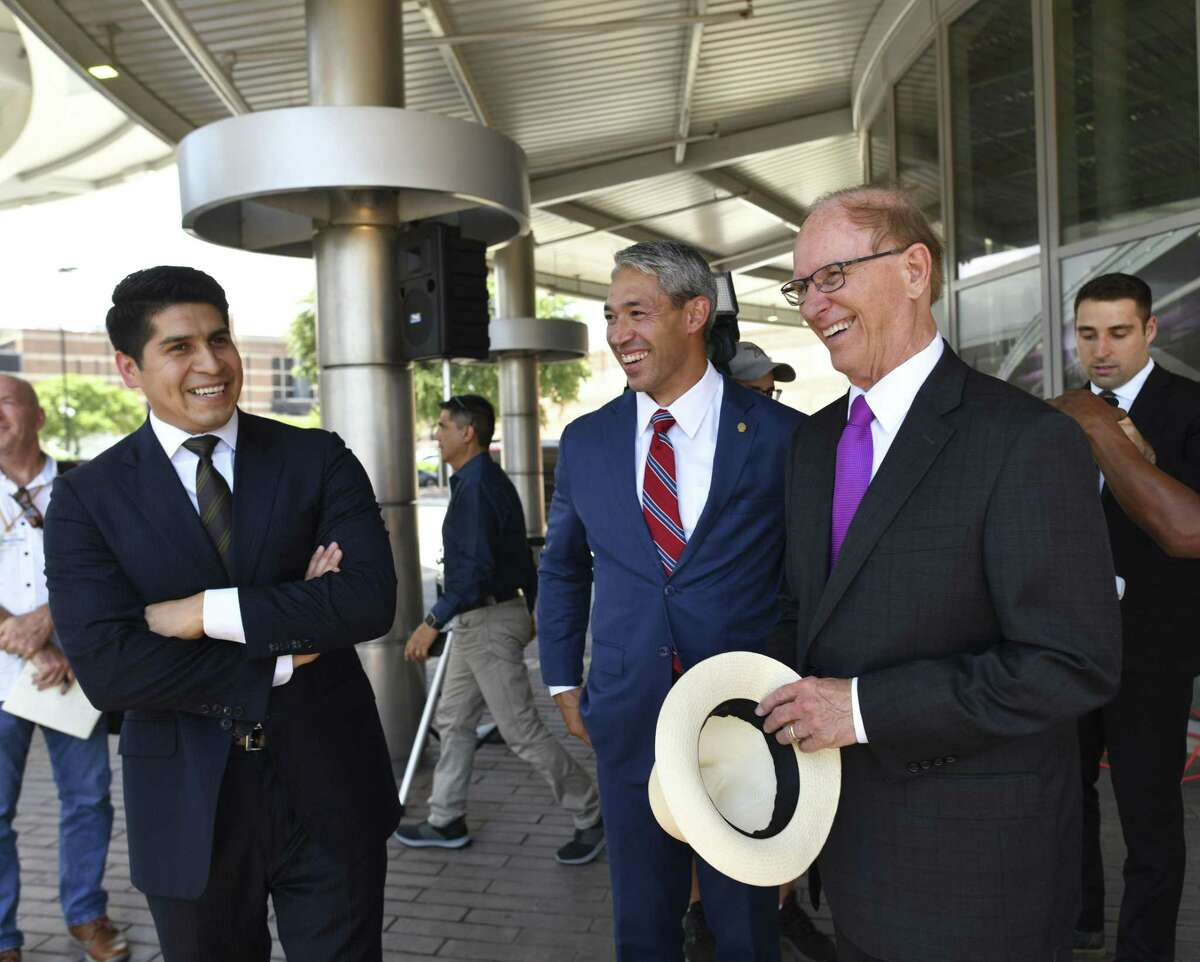 Rey Saldaña, left, endorsed for VIA Metropolitan Transit board chair by Mayor Ron Nirenberg, middle, and County Judge Nelson Wolff, right, speaks with them after a press conference at Centro Plaza at VIA Villa on Tuesday, June 18, 2019.