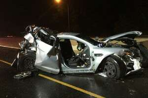 A state police trooper was seriously injured early Sunday, June 16, 2019 while three others suffered minor injuries after a car crashed into a parked cruiser in Fairfield, Conn.