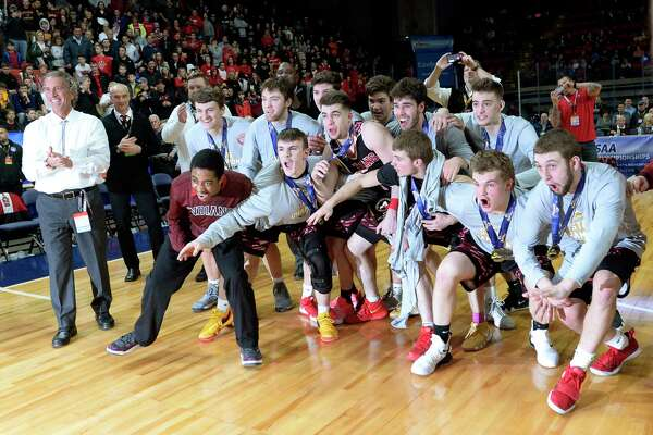 Glens Falls players wait to be presented with championship plaque after the Class B final at the NYSPHSAA Boys Basketball Championships in Binghamton, N.Y., Saturday, March 16, 2019. Glens Falls won the Class B state title with a 75-74 overtime win over Lowville-III. (Adrian Kraus / Special to the Times Union)