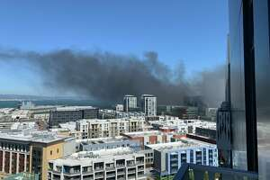A fire sent a cloud of smoke above Mission Bay on Tuesday, June 18, 2019.