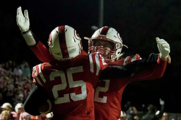 Guilderland tight end Nick Popolizio chest bumps running back Vin Lia following a touchdown by Lia during a game against CBA on Friday, Oct. 19, 2018 in Guilderland, N.Y. (Jenn March, Special to the Times Union )