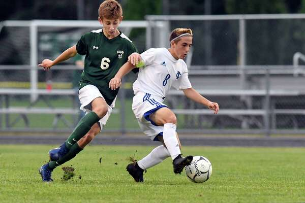 Ichabod Crane's Anthony Carlucci (8) moves the ball past Schalmont's Matt Horwedel (6) during a Section II boys' soccer game Wednesday, Sept. 12, 2018, in Rotterdam, N.Y. (Hans Pennink / Special to the Times Union)