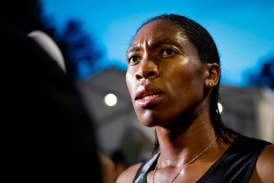 TOPSHOT - South African Caster Semenya speaks with journalists after the women's 2000m race during the France's LNA (athletics national association) Pro Athle Tour meeting on June 11, 2019 at the Jean-Delbert stadium in Montreuil, a Paris neighbouring suburb. - The double 800m Olympic champion, who was racing for the first time since a controversial new gender ruling came into effect, finished in 5min 38.19sec ahead of Ethiopian pair Hawi Feysa and Adanech Anbesa. (Photo by GEOFFROY VAN DER HASSELT / AFP)GEOFFROY VAN DER HASSELT/AFP/Getty Images Photo: AFP / Getty Images
