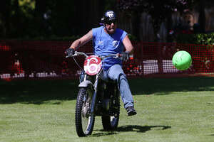 Members of the Motorcycle Soccer Club play a game during the LeMay Motorcycle Days in Tacoma, Saturday, June 15, 2019.