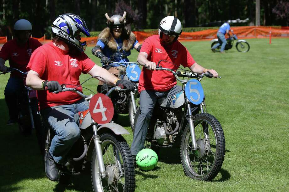 Members of the Motorcycle Soccer Club play a game during the LeMay Motorcycle Days in Tacoma, Saturday, June 15, 2019. Photo: Genna Martin, SEATTLEPI / GENNA MARTIN