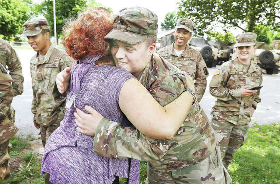 As the area's second worst flood in recorded history starts to wind down, all the members of the Illinois National Guard 233rd Military Police Company got a big hug goodbye Tuesday at the Hartford Community Center from Tammy Iskarous. Iskarous, from the Riverbend Family Ministries, worked with the troops to keep them fed and supplied with essentials, like bug repellant, during their stay in the area. Photo: John Badman | The Telegraph