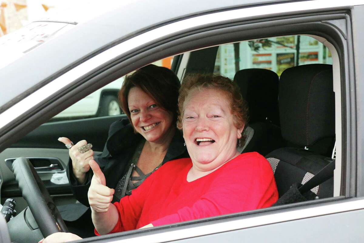 Mandi Whitmire and Lydia Davis (driver) were thumbs up as they waited with great anticipation for their favorite hamburger eatery reopened in Liberty, Texas.. They were the first in line at the drive-through.